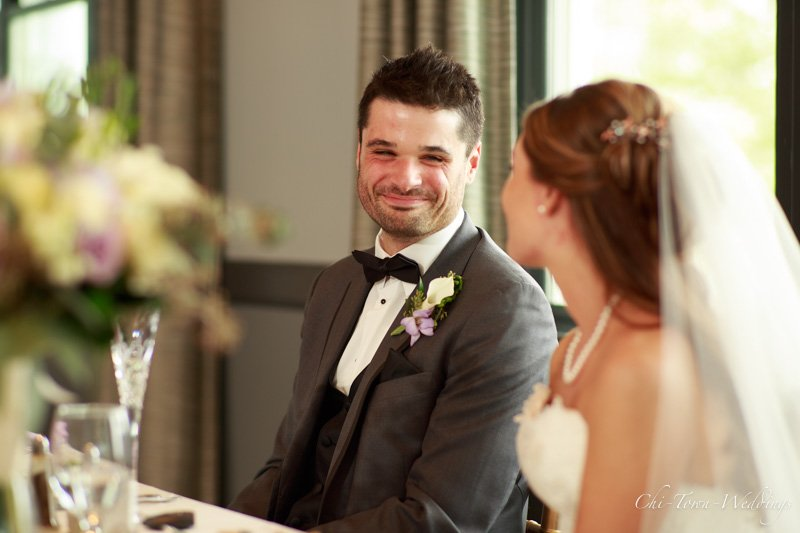 Bride and Groom candid laughing at table