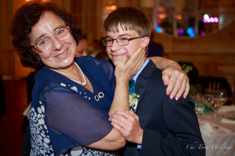 Grandman dancing with grandchild at wedding candidly