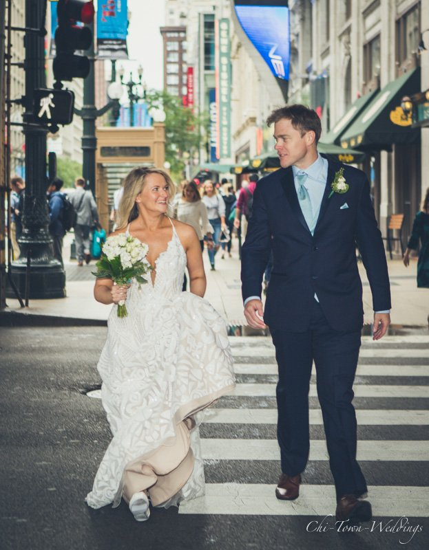 Candid Bride and Groom walking under el tracks Chicago