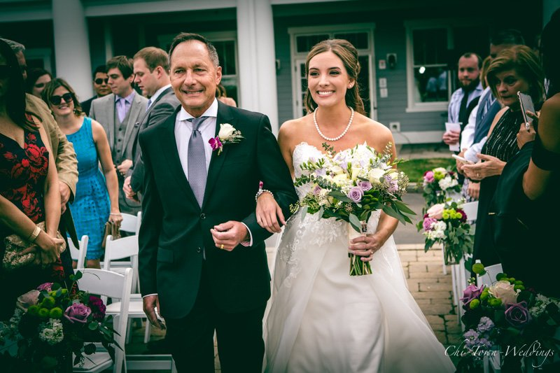 Candid Bride with her father walking down the isle