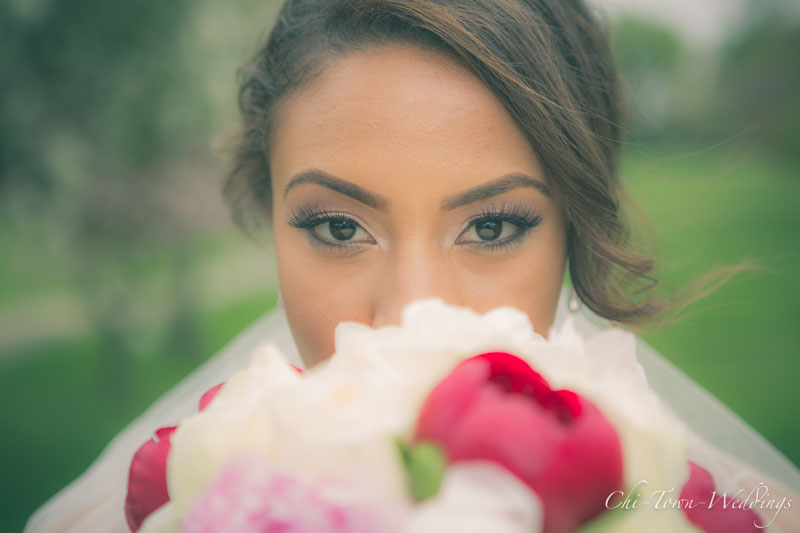Brides eyes over her flowers