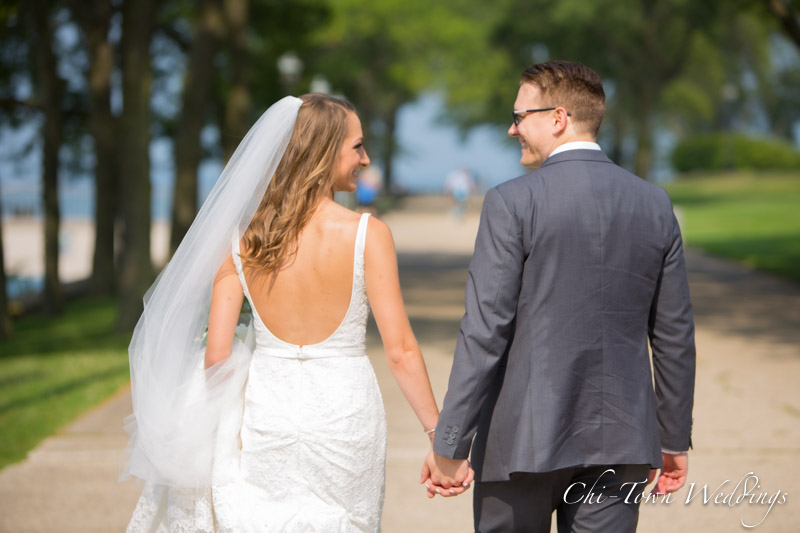 www.Chi-Town-Weddings.com  Bride and Groom waling holding hands Chicago Olive Park