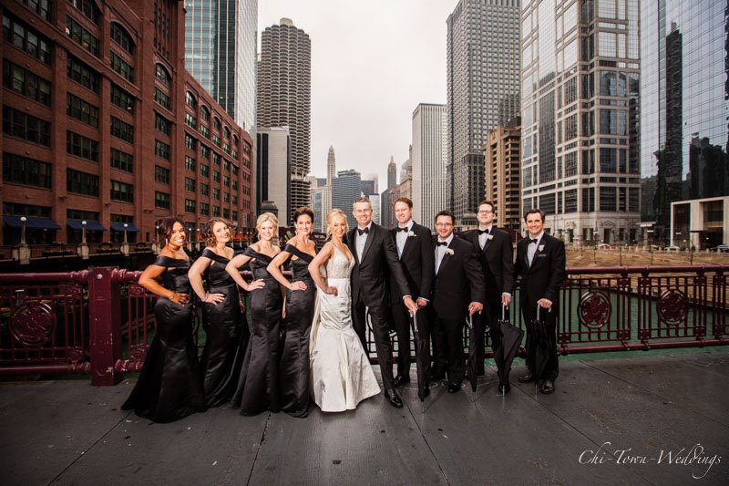 Wedding Party posing on Lasalle Street Bridge Chicago