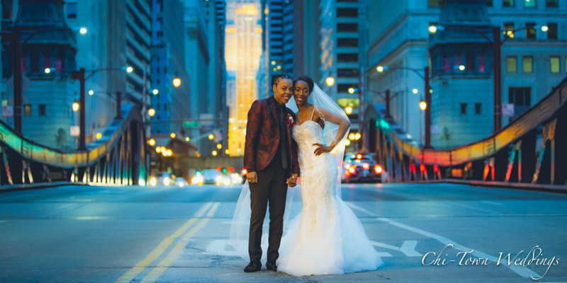 www.Chi-Town-Weddings.com Brides at dusk Lasalle st Chicago