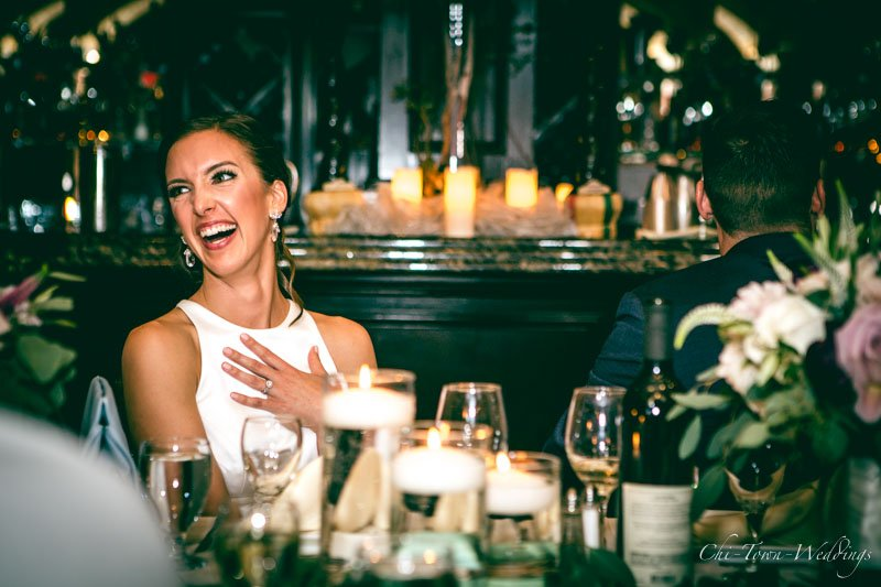 Bride and Groom laughing in a candid moment