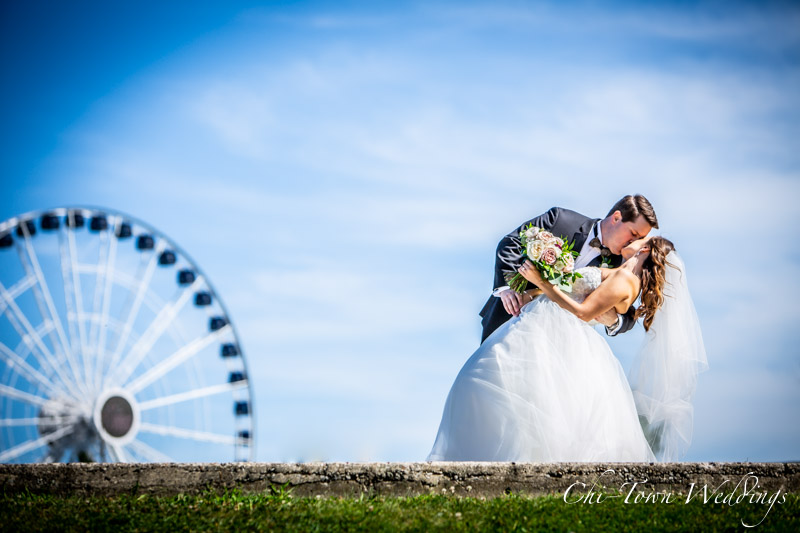 www.Chi-Town-Weddings.com  Kiss and dip Bride and Groom Navy Pier Chicago