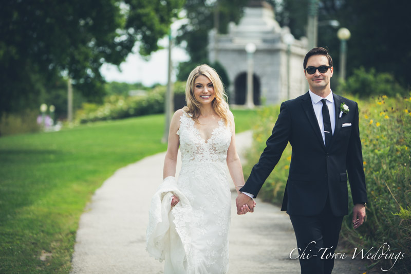 www.Chi-Town-Weddings.com  Bride and groom walking holding hands Chicago