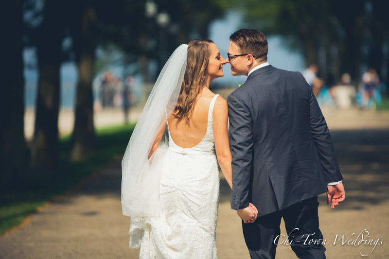 www.Chi-Town-Weddings.com Bride and Groom kissing holding hands