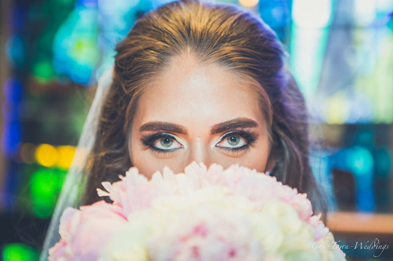 close up of Bride eyes and flowers